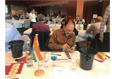 Wine judge Subhash Arora contemplates a blue wine at Mundus Vini